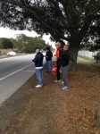 Finish line crew: Karl Matzke, David Paulsen, trafficator John Novitsky, and race-husband Jono Coulter